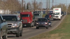 Trucking, trucks in traffic long shot Stock Footage