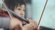 Game on a violin Stock Footage