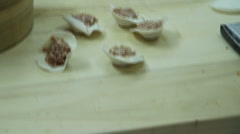 Dumplings being hand made in Beijing, China. 2 Stock Footage