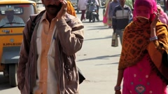Indian man and woman on cell phone Stock Footage