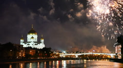 Stock Video Footage of Bright fireworks erupt over bridge at Cathedral of Christ Savior