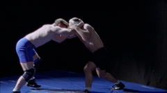 Two wrestlers compete on the mat. Stock Footage
