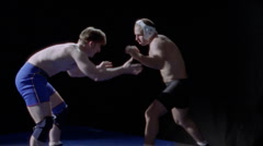 Two men wrestle on a mat on the floor. Stock Footage