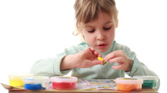 Little girl sculpts wasp from plasticine Stock Footage