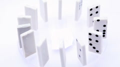 Dominoes with black dots stand vertically aligned in circle and rotate - stock footage