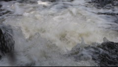 White water rushing over rocks in a small waterfall. Stock Footage
