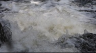 Stock Video Footage of White water rushing over rocks in a small waterfall.