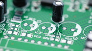 Stock Video Footage of Printed circuit board with radio components rotates counterclockwise