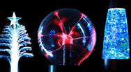 Stock Video Footage of Energy lines move inside plasma ball and two decorative lamps by each side