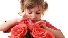 Nice little girl looks inside pink rose in beautiful bouquet Stock Footage
