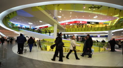 People on crossings in new shopping and entertainment center TROYKA Stock Footage