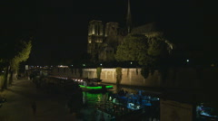 Paris night cruise boat passes Notre Damn Stock Footage