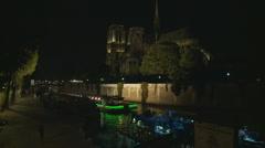 Paris night cruise boat passes Notre Damn - stock footage