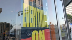 "Borders ""EVERYTHING ON SALE"" Sign - stock footage"