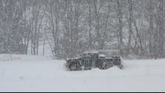 PIckup truck stuck in blizzard Stock Footage