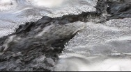Stock Video Footage of Winter stream flowing under ice 2