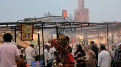People at the food Stalls in the Djemma  El- Fna  Square, Marrakech, Morocco Stock Footage