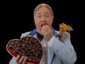 Stock Video Footage of Awkward Man eating Valentine's Candy
