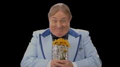 Stock Video Footage of Awkward Man presenting Flowers