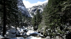 Mountain between trees with water and rocks Stock Footage