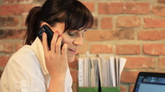 Businesswoman receiving phone call during work, steadicam shot HD Stock Footage