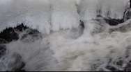Stock Video Footage of Winter stream flowing under ice formation 3