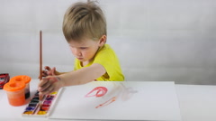 boy draws paint - stock footage