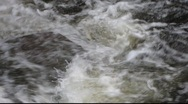 Stock Video Footage of White water rushing over rocks 1