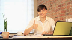 Businesswoman in the office signing documents and showing ok sign HD Stock Footage