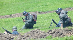 Nazi soldiers shooting from trench - stock footage