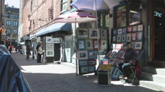 Art Street Vendors Selling Paintings In Old Montreal Canada Stock Footage