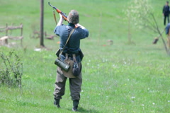 Nazi soldier shooting from a rifle - stock footage