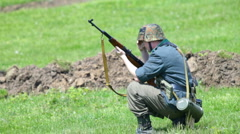 Nazi soldier preparing to shoot from rifle Stock Footage
