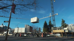 Crane Unloading A Truck At A North American Construction Site Stock Footage