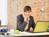Young businesswoman working on computer and smiling to camera NTSC Stock Footage