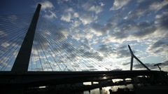 zakim bridge at sunset with time lapse clouds - stock footage