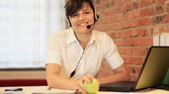 Attractive helpdesk consultant smiling to the camera, steadicam shot HD Stock Footage