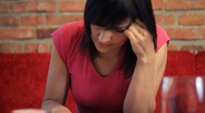 Stock Video Footage of Sad stressed woman overwhelmed by bills, steadicam shot HD