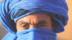 Male in traditional blue Touareg Headress, Sahara Morocco Africa Stock Footage