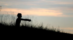 Outdoors Meditation at sunset Stock Footage