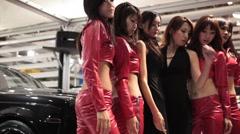 Asian Girl Car Models at Custom Car Show Stock Footage