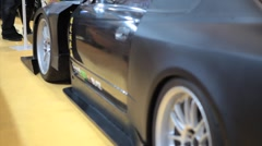 Close Up Shot of a custom Black Car ground effects package and Spoiler Kit Stock Footage