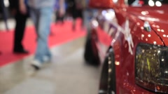 Sweet shot of the Front of a Custom Car Close Up at Car Show with hazard lights  Stock Footage