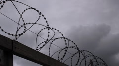 Barbed wire fence with moody sky timelapse Stock Footage