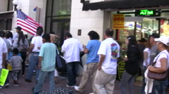 People on sidewalk - Immigration march and rally Stock Footage