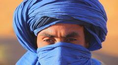 Male in traditional blue Touareg Headress, Sahara Morocco Africa - stock footage