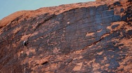 Stock Video Footage of Rock Climber climbing up a beautiful rock face