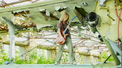 Girl with the electronic guitar Stock Footage