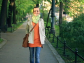 Happy woman walking  in the park, shot at 60fps, steadicam shot Stock Footage