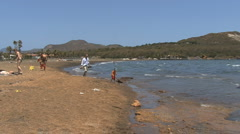 Vulcano people on shore Stock Footage